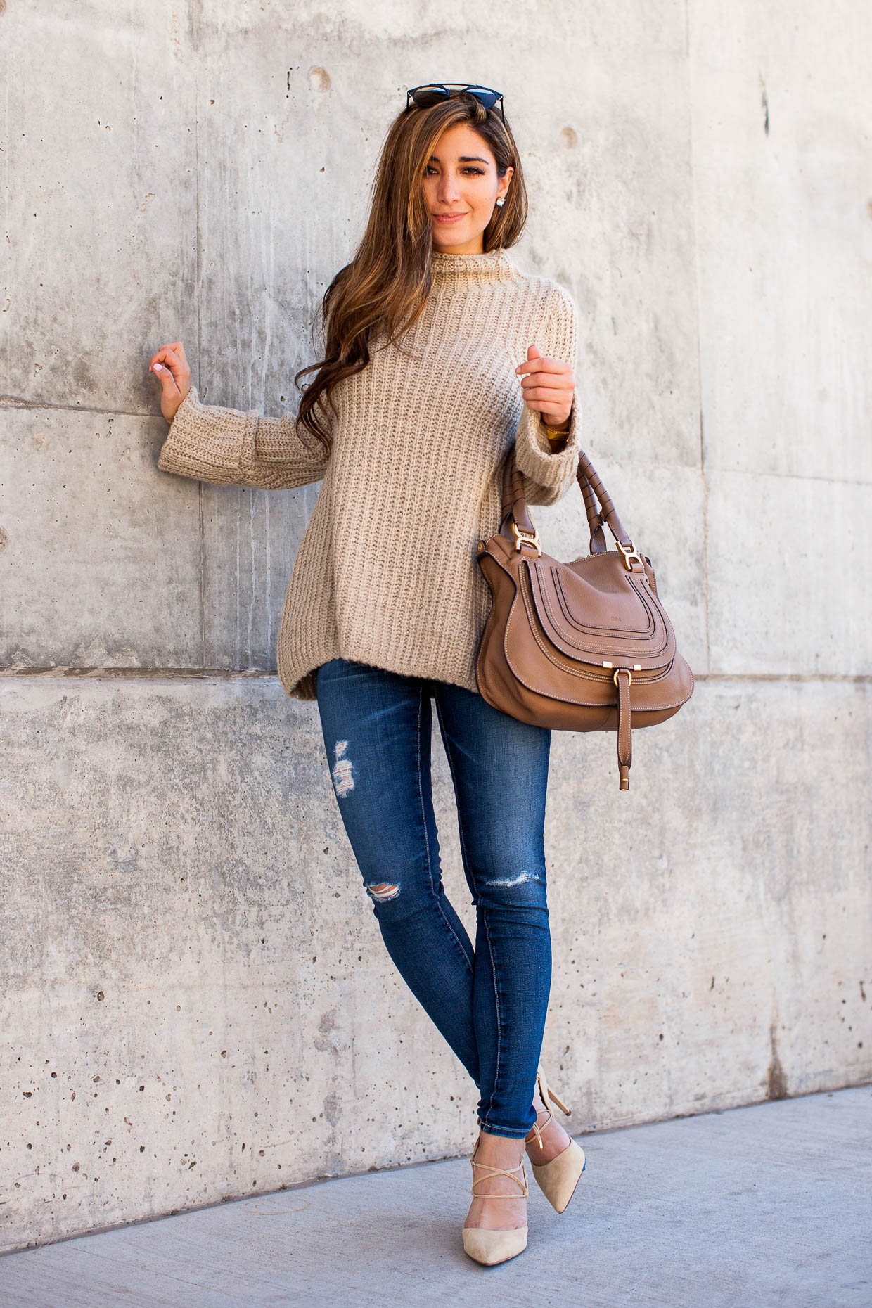 The Darling Detail wears AG distressed jeans