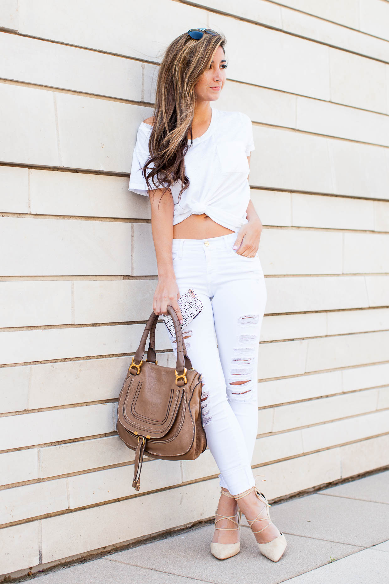 The Darling Detail wears Frame distressed white denim from Nordstrom