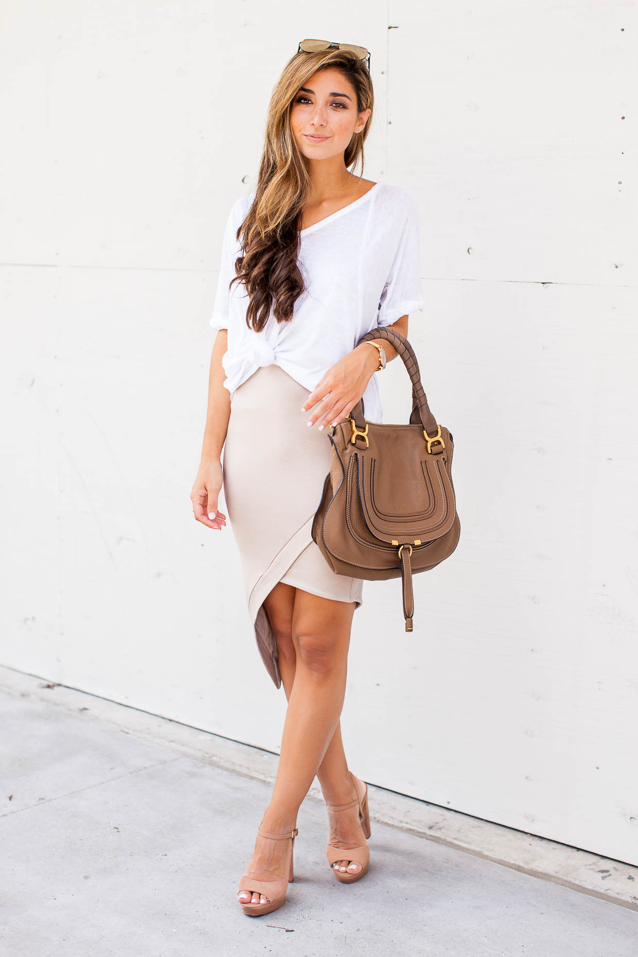 Fashion Blogger The Darling Detail is wearing a Free People Tee with the De Lacy Sara Skirt and Krysta Platform Sandals.