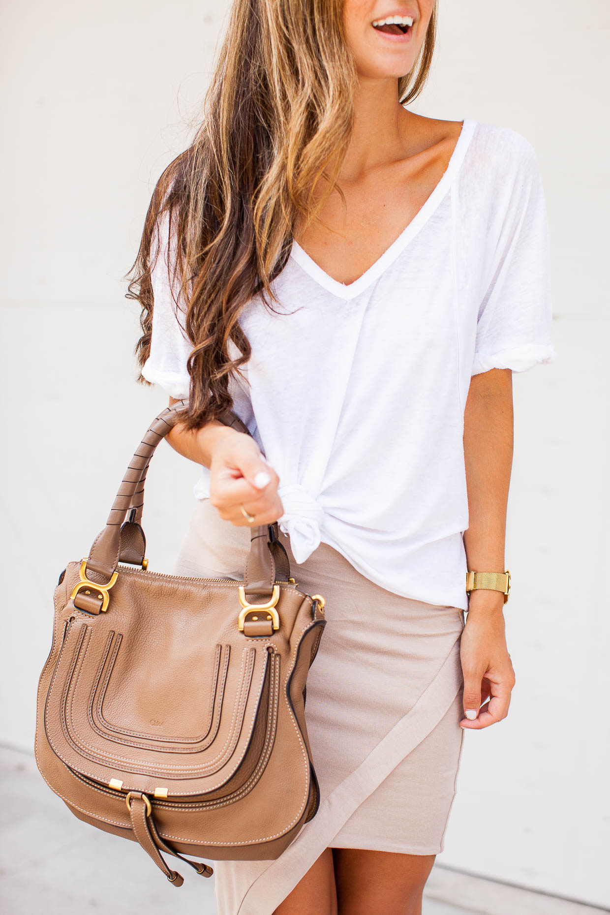 The Darling Detail styled a Free People Tee with the De Lacy Sara Skirt, accessorizing with the Chloe Marcie Small Leather Satchel, Le Specs 'The Prince' Sunglasses, and a Larsson & Jennings Watch.