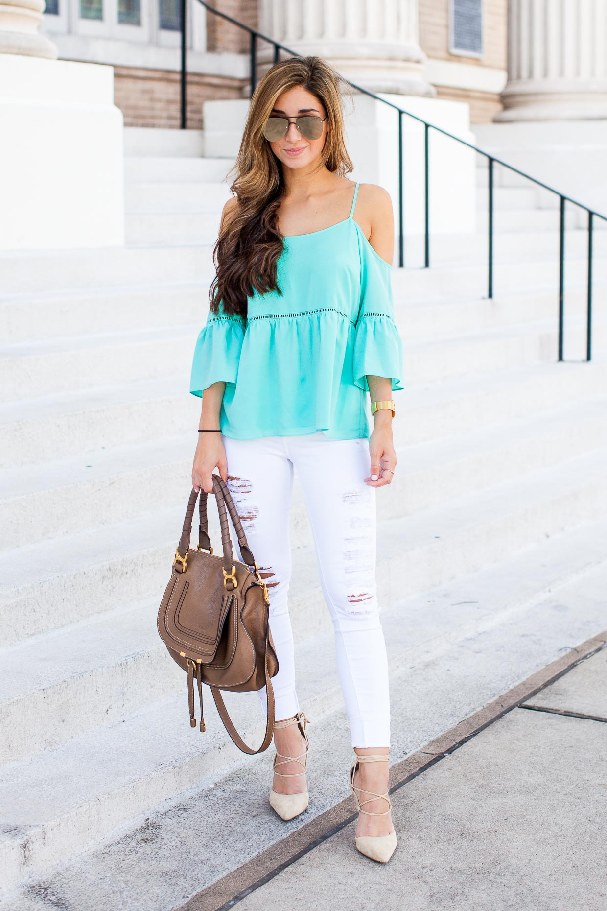 The Darling Detail The Darling Detail is wearing a Cold Shoulder Peasant Top and FRAME 'Le Color Rip' Skinny Jeans.