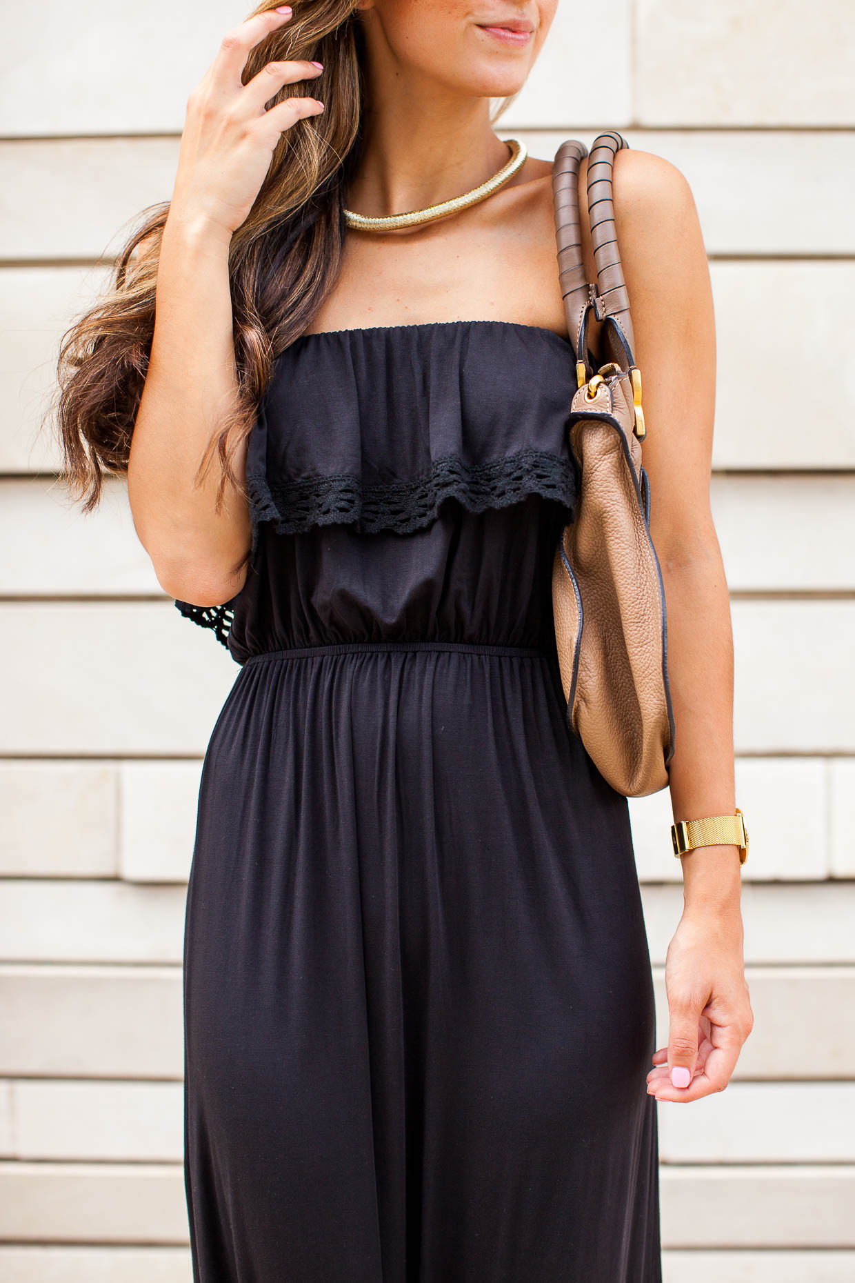 Fashion Blogger The Darling Detail is wearing a Ruffled Strapless Maxi Dress, with 'Krysta' Platform Sandals, Dior Sunglasses, a Larsson & Jennings Watch, and the Chloe 'Marcie – Small' Leather Satchel.