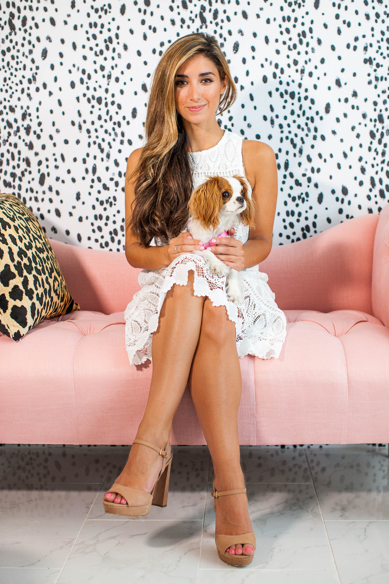 Fashion Blogger The Darling Detail is wearing a J.O.A. Lattice Embroidered Midi Dress and Vince Camuto 'Krysta' Platform Sandals, sitting on a One Kings Lane Cameron Tufted Chaise against a backdrop of Spoonflower Charcoal Dots Wallpaper.