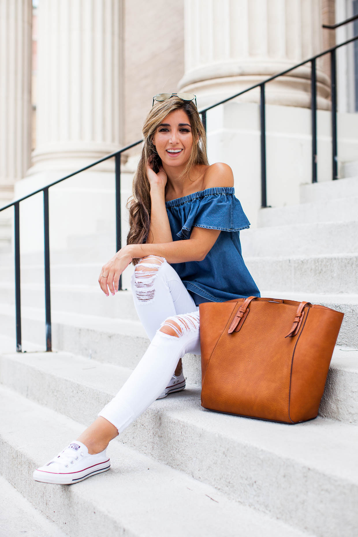 The Darling Detail is wearing a Chelsea28 Off the Shoulder Chambray Top, 'Le Color Rip' Skinny Jeans, Converse 'Shoreline' Sneakers, 'The Prince' 57mm Sunglasses, and carrying a Sole Society Faux Leather Trapeze Tote.