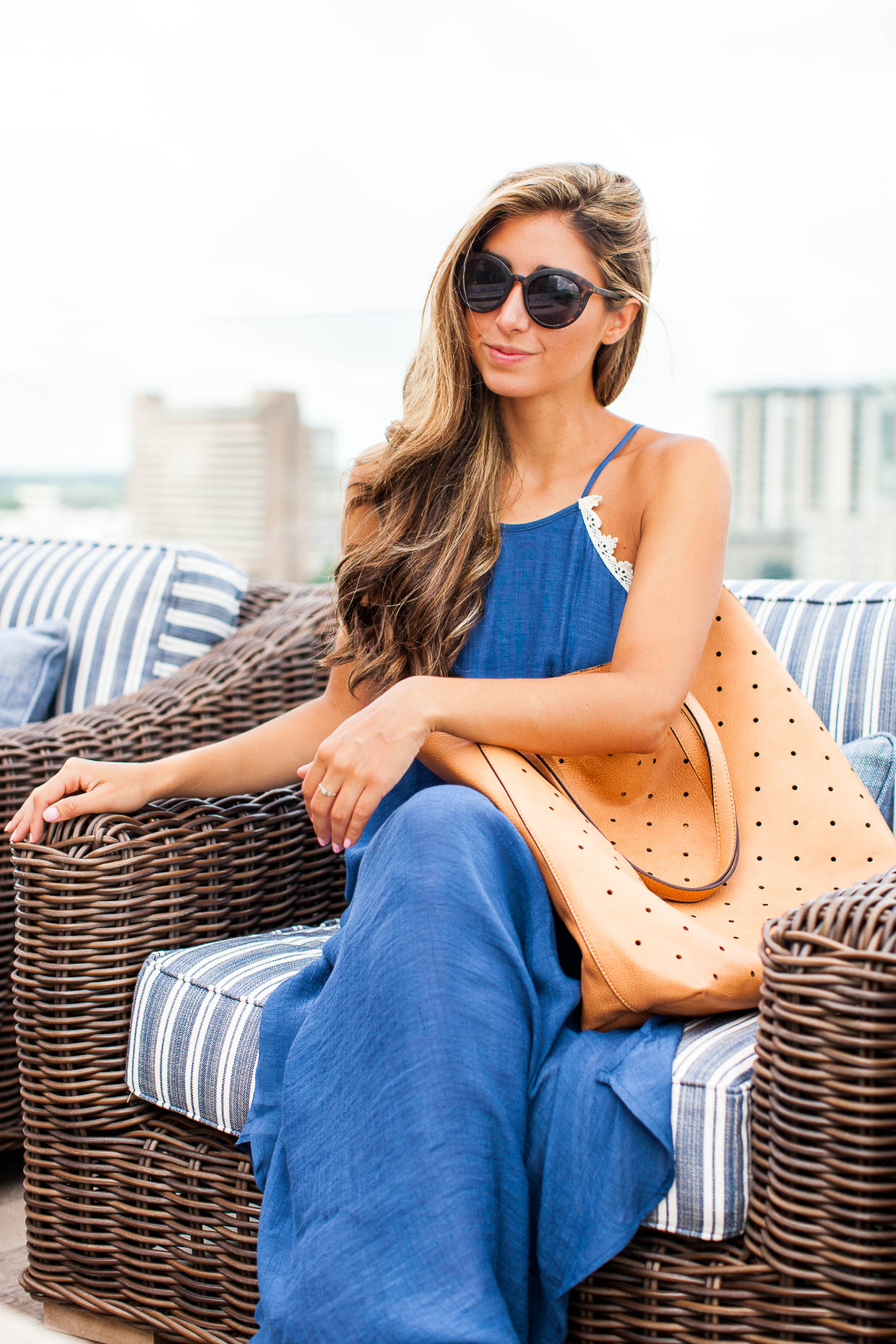 The Darling Detail is wearing a Love Squared Crochet Trim Maxi Dress, along with the Sole Society Farrow Tote and Garey Cateye Sunnies.