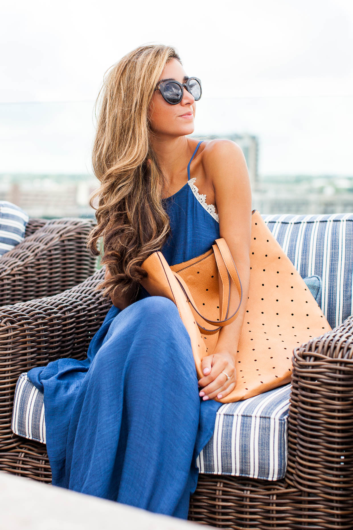 Fashion Blogger The Darling Detail is wearing a Love Squared Crochet Trim Maxi Dress, along with the Sole Society Farrow Tote and Garey Cateye Sunnies.