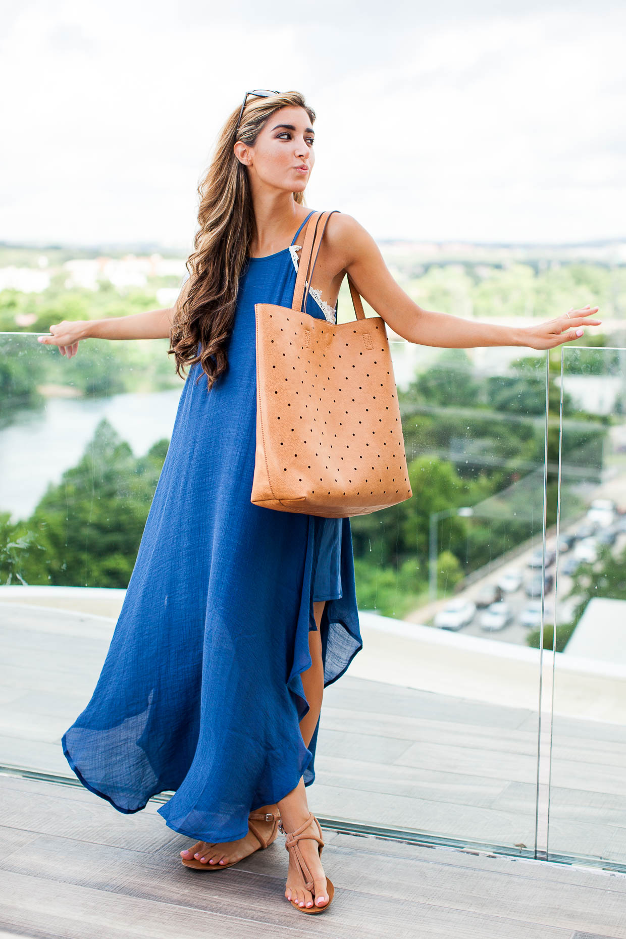 Fashion Blogger The Darling Detail is wearing a Love Squared Crochet Trim Maxi Dress, along with Sole Society Topaz Sandals, the Farrow Tote, and Garey Cateye Sunnies.