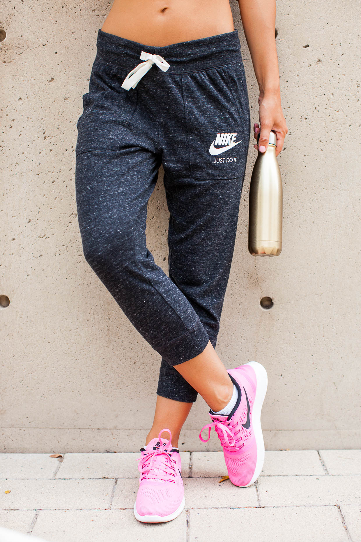 The Darling Detail is sporting Nike 'Gym Vintage' Capris and Nike's 'Free RN' Running Shoes and using a S'well 'Sparkling Champagne' Stainless Steel Water Bottle.