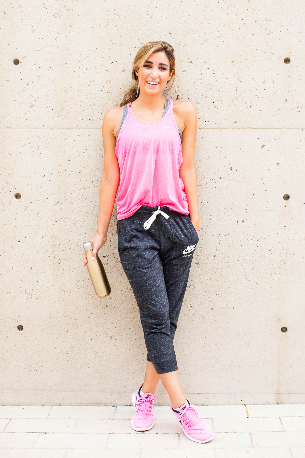 The Darling Detail is sporting Nike 'Gym Vintage' Capris, a Nike 'Pro - Classic' Dri-FIT Padded Sports Bra and a 'Cool Breeze' Racerback Dri-FIT Tank, wearing Nike's 'Free RN' Running Shoes, and using a S'well 'Sparkling Champagne' Stainless Steel Water Bottle.