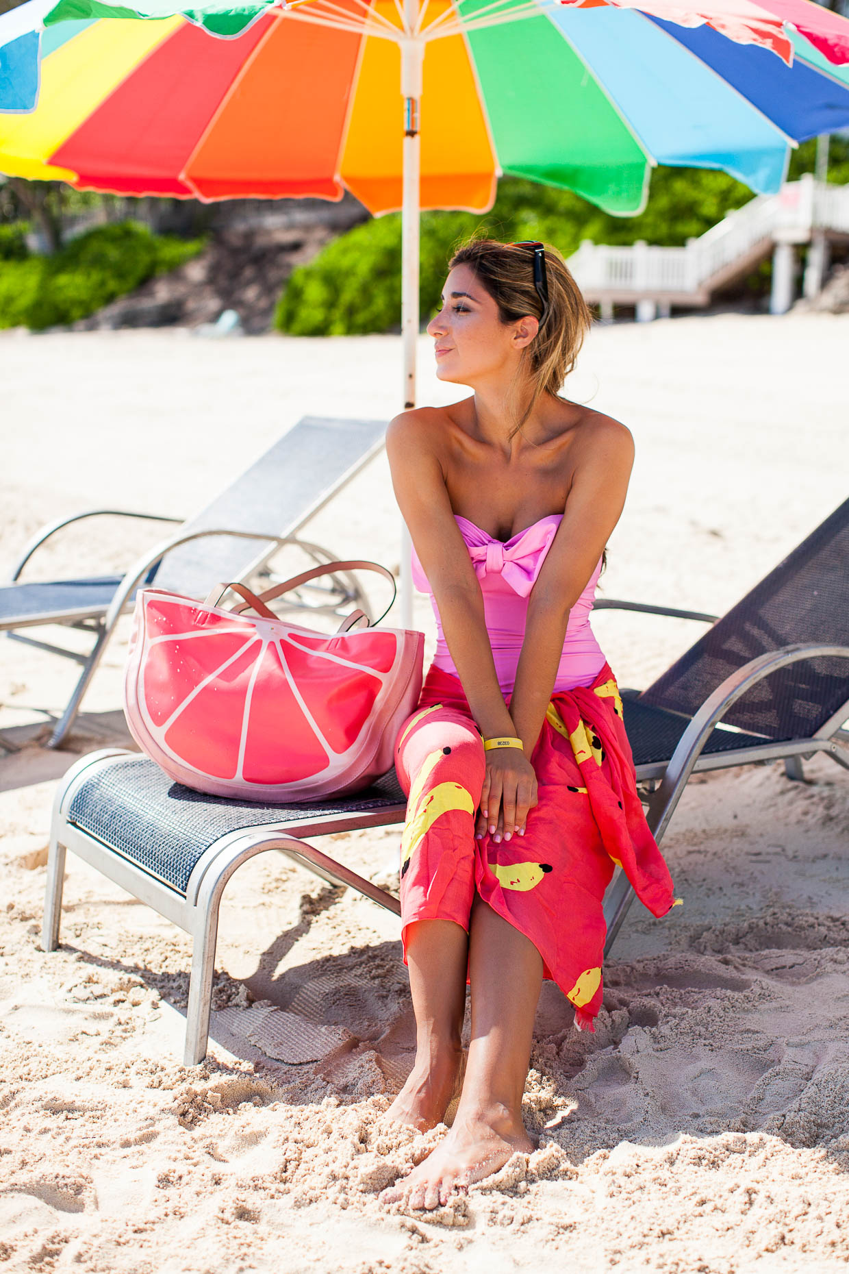 Fashion Blogger The Darling Detail is wearing the Kate Spade Georgica Beach Bandeau Maillot with the That's Bananas Oblong Scarf, and is sporting the Flights of Fancy Grapefruit Tote and Sharlotte Sunglasses.