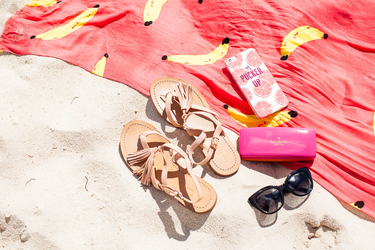 The Darling Detail is at the beach with Kate Spade products, including the That's Bananas Oblong Scarf, the Pucker Up iPhone 6 Case, Clorinda Sandals, and Sharlotte Sunglasses.