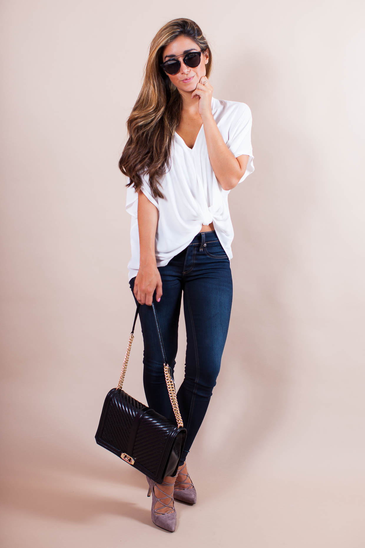 Fashion Blogger The Darling Detail is wearing a Lush Twist Front Woven Top with Rag & Bone Skinny Jeans, Vince Camuto 'Barsha' Lace-up Pumps, Dior 'So Real' 48mm Sunglasses, and a Rebecca Minkoff 'Love Jumbo' Crossbody Bag.