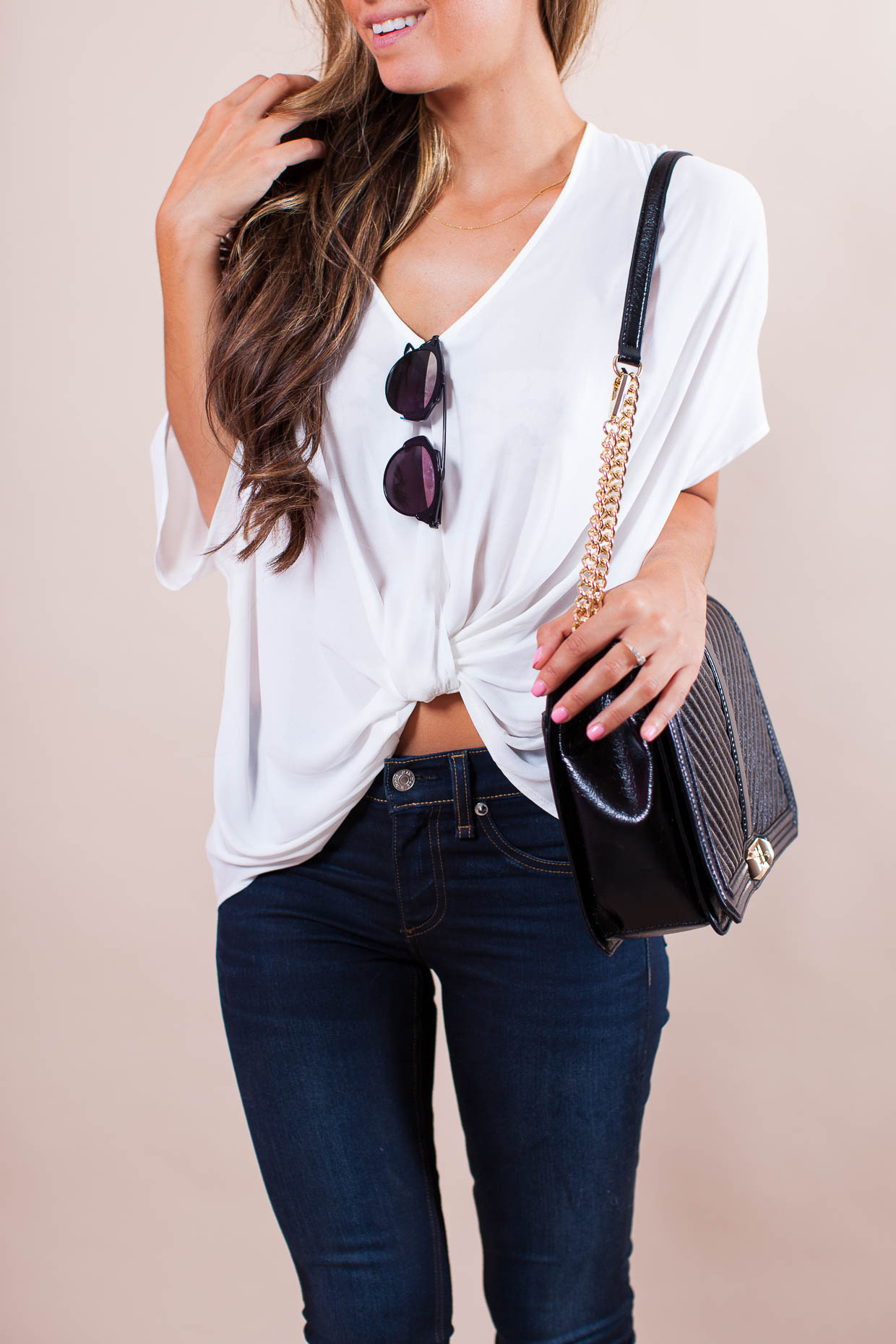 Fashion Blogger The Darling Detail is wearing a Lush Twist Front Woven Top with Rag & Bone Skinny Jeans, Dior 'So Real' 48mm Sunglasses, and a Rebecca Minkoff 'Love Jumbo' Crossbody Bag.