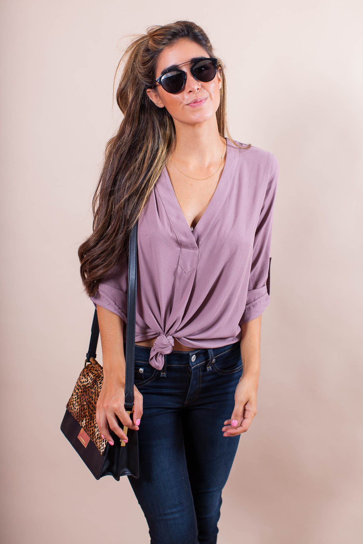 The Darling Detail is wearing a Lush V-Neck Crepe Blouse with Rag & Bone Skinny Jeans, Dior 'So Real' 48mm Sunglasses, and the Vince Camuto 'Abril' Leather Shoulder Bag.