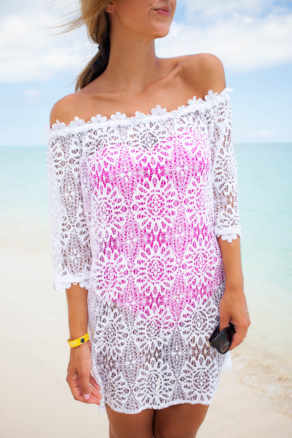 Fashion Blogger The Darling Detail is wearing a La Blanca Twist Front Bandeau One-Piece Swimsuit and a Topshop Lace Bardot Cover-Up Dress.