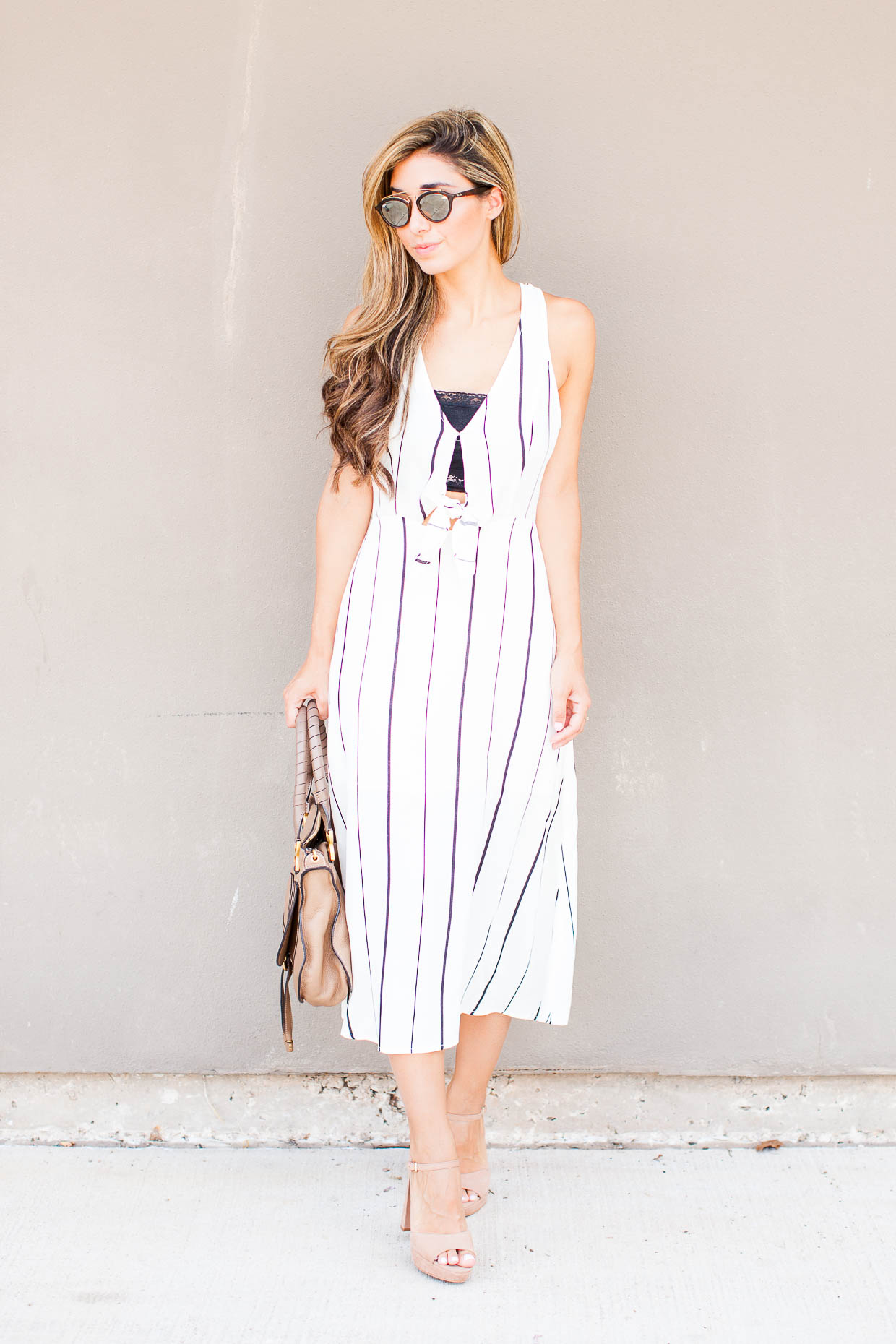 Fashion Blogger The Darling Detail is wearing an ASTR Tie Front Midi Dress, a Free People Scalloped Lace Bandeau, with Vince Camuto 'Krysta' Sandals, Ray-Ban 'Highstreet' Sunglasses, and holding the Chloe 'Medium Marcie' Leather Satchel.