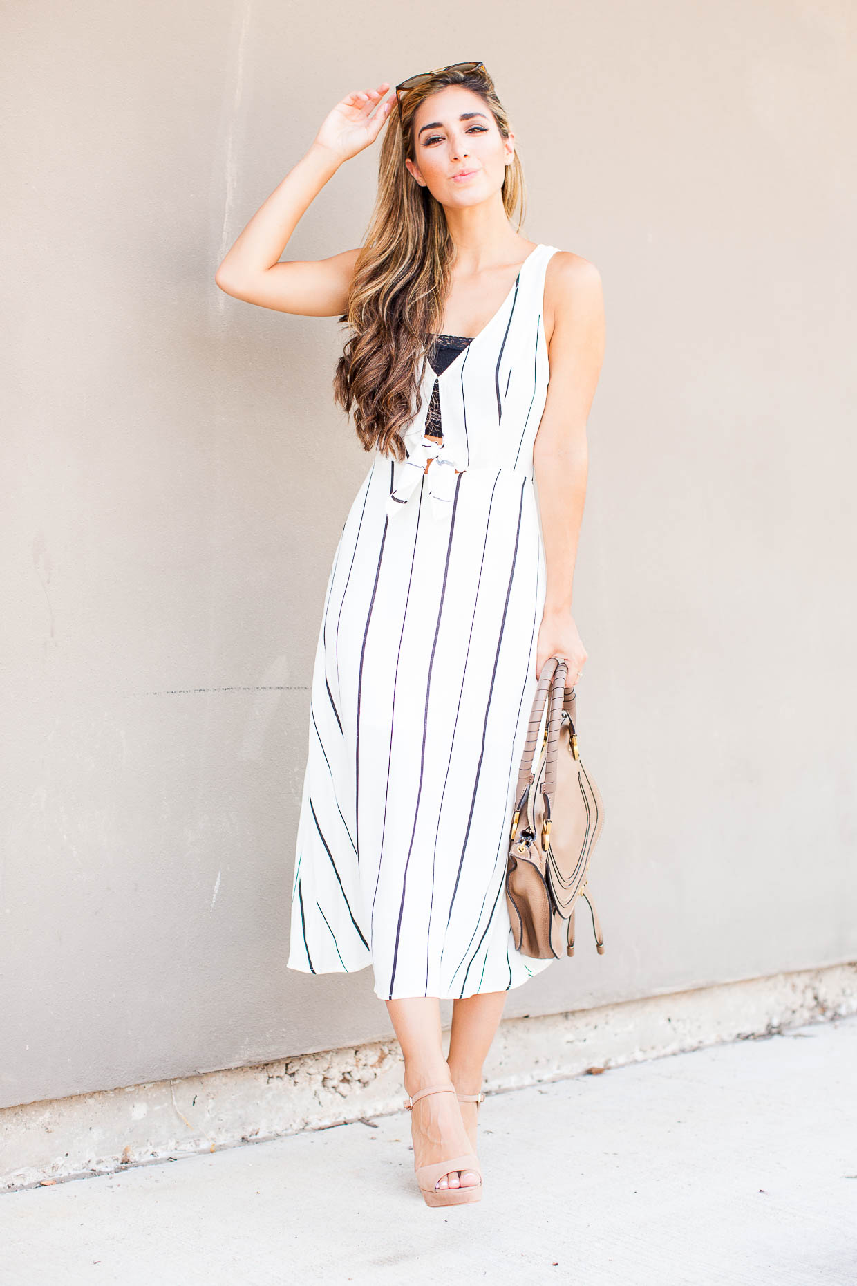 The Darling Detail is wearing an ASTR Tie Front Midi Dress, a Free People Scalloped Lace Bandeau, with Vince Camuto 'Krysta' Sandals, Ray-Ban 'Highstreet' Sunglasses, and holding the Chloe 'Medium Marcie' Leather Satchel.