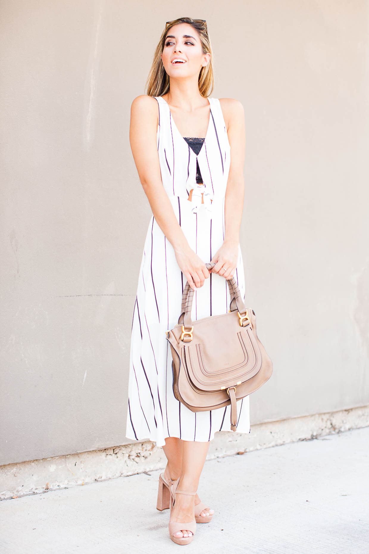 Fashion Blogger The Darling Detail is wearing an ASTR Tie Front Midi Dress, a Free People Scalloped Lace Bandeau, Ray-Ban 'Highstreet' Sunglasses, and is holding the Chloe 'Medium Marcie' Leather Satchel.