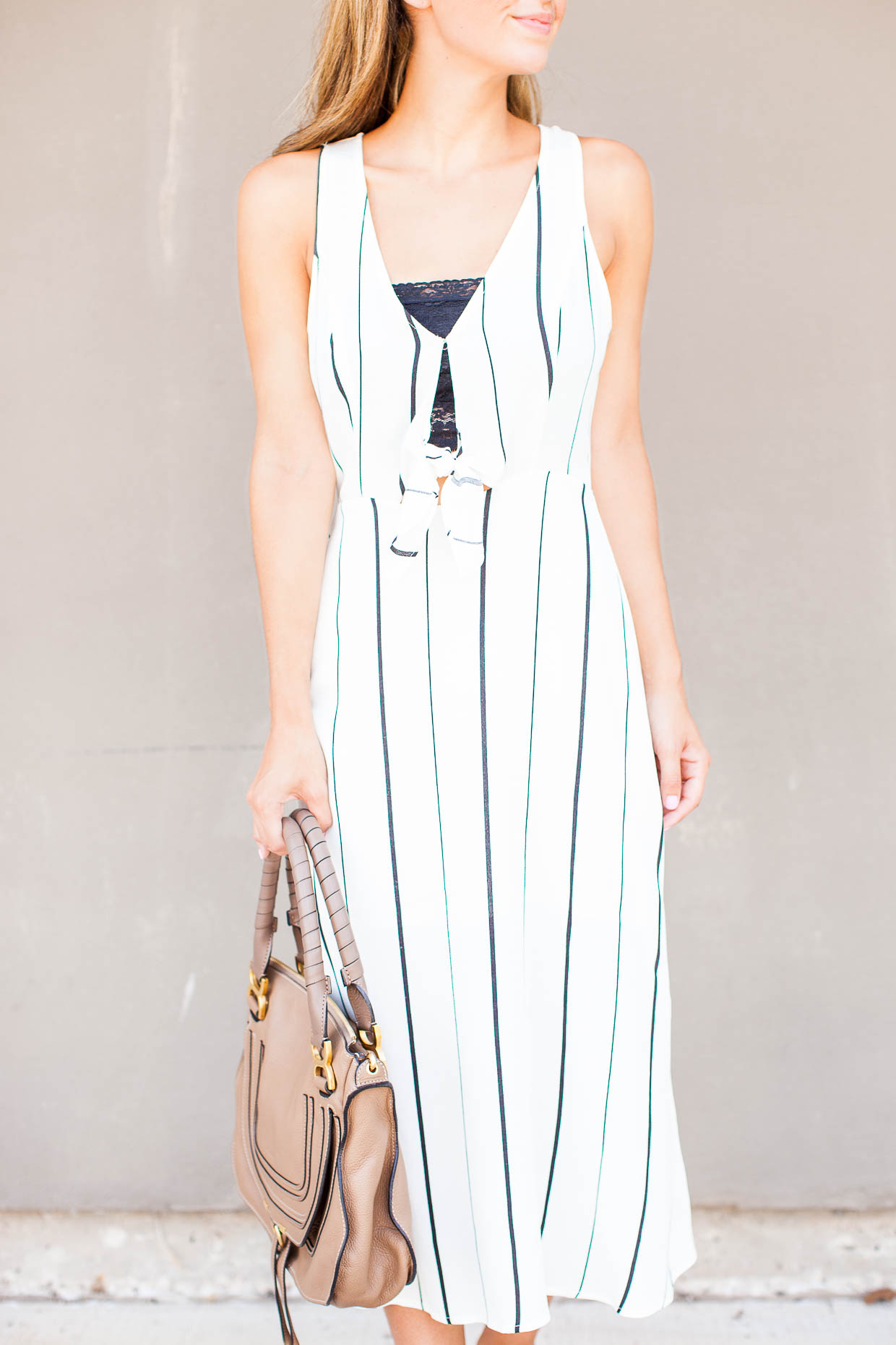 The Darling Detail is wearing an ASTR Tie Front Midi Dress, a Free People Scalloped Lace Bandeau, and is holding the Chloe 'Medium Marcie' Leather Satchel.