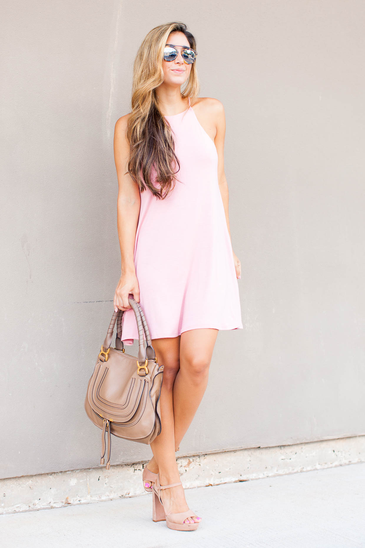 Fashion Blogger The Darling Detail is wearing a Socialite High Neck Knit Swing Dress with Vince Camuto 'Krysta' Sandals and Westward Leaning Flower 1 Sunglasses, holding a Chloe 'Medium Marcie' Leather Satchel.