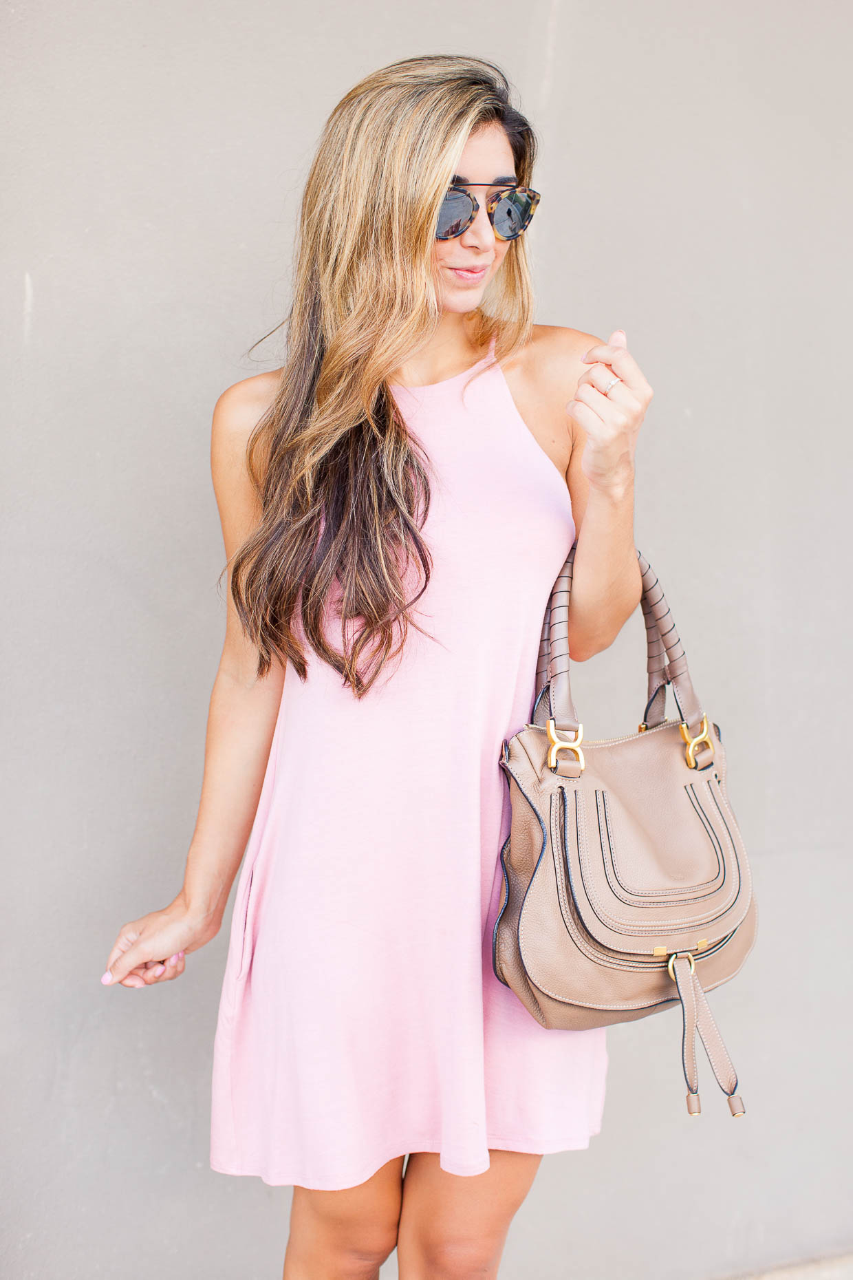 The Darling Detail is wearing a Socialite High Neck Knit Swing Dress and Westward Leaning Flower 1 Sunglasses, and is holding a Chloe 'Medium Marcie' Leather Satchel.