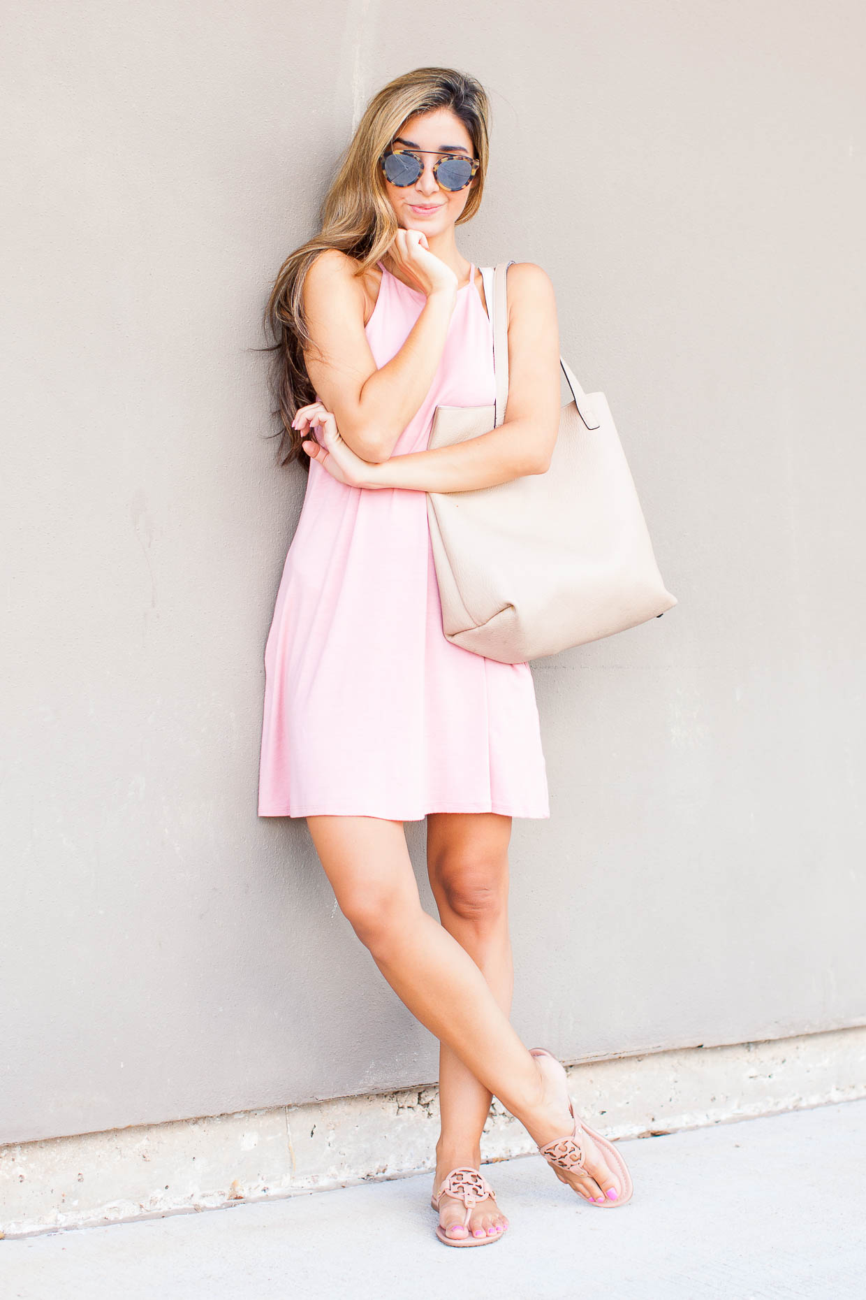 Fashion Blogger The Darling Detail is wearing a Socialite High Neck Knit Swing Dress with Tory Burch Miller Flip Flops and Westward Leaning Flower 1 Sunglasses, holding a Street Level Reversible Faux Leather Tote.