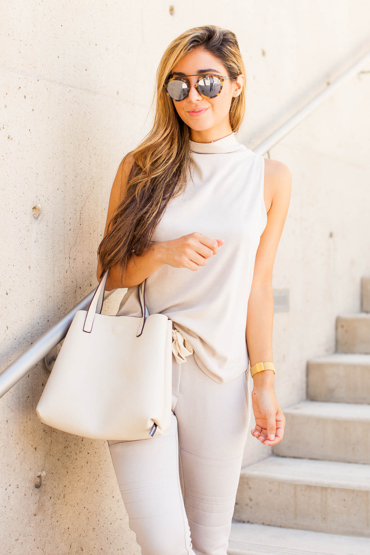 The Darling Detail is wearing a Leith Funnel Neck Tank, Sincerely Jules 'Lux' Skinny Cotton Jogger Pants, Westward Leaning Flower 1 Sunglasses, a Larsson & Jennings 'Lugano' Mesh Strap Watch, Tory Burch 'Miller' Flip Flops, holding a Street Level Reversible Faux Leather Tote.