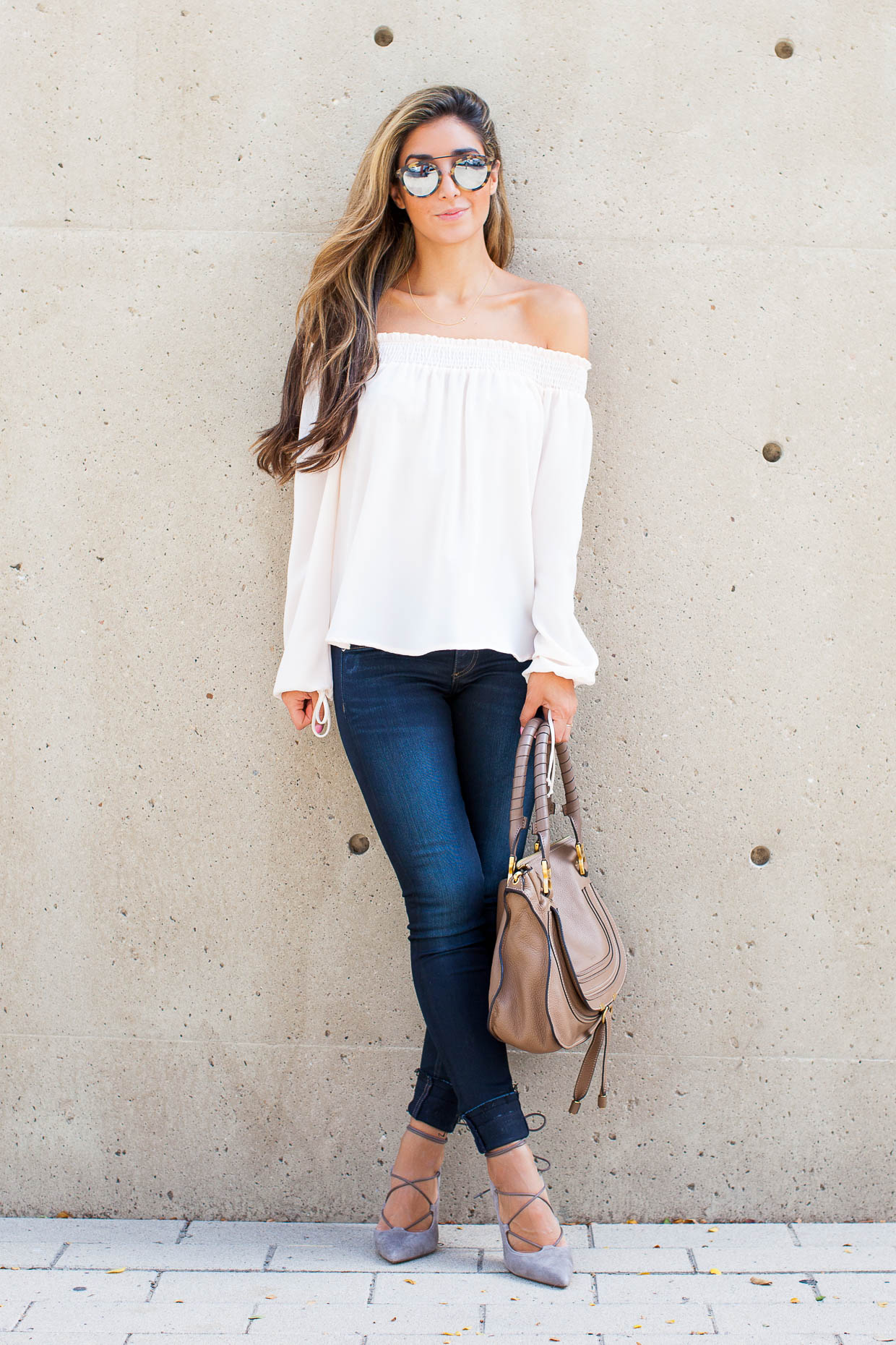 Fashion Blogger The Darling Detail is wearing a Chelsea28 Off the Shoulder Top, rag & bone/JEAN 'The Skinny' Skinny Jeans (Dearborn), Sole Society Madeline Lace-Up Pumps, Westward Leaning Flower 1 Sunglasses, and is holding a Chloe 'Marcie - Small' Leather Satchel.