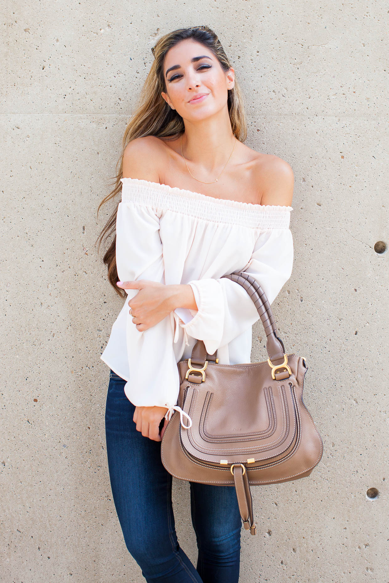 The Darling Detail is wearing a Chelsea28 Off the Shoulder Top and rag & bone/JEAN 'The Skinny' Skinny Jeans (Dearborn), Westward Leaning Flower 1 Sunglasses, and is holding a Chloe 'Marcie - Small' Leather Satchel.