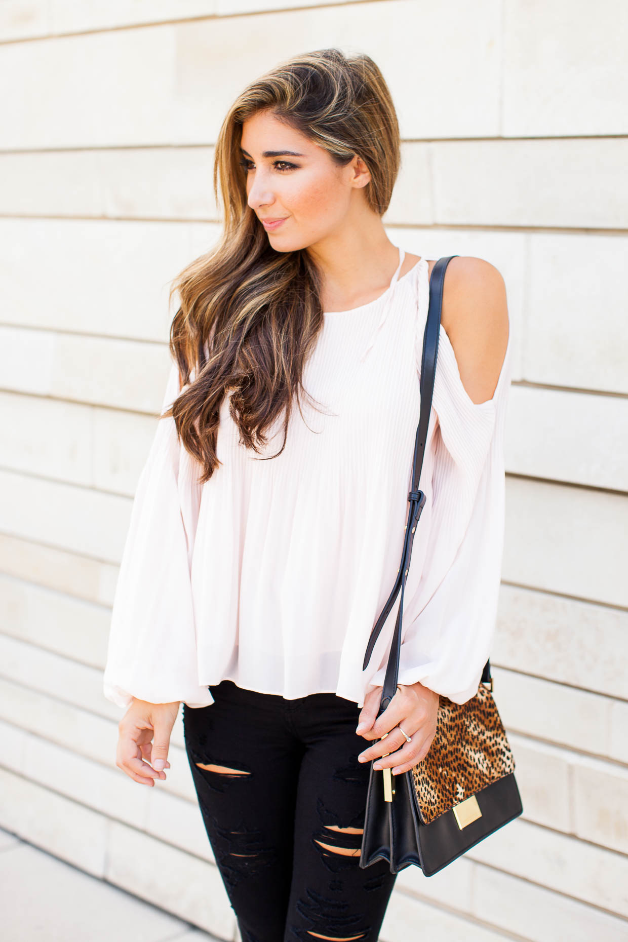 The Darling Detail is wearing an ASTR Pleated Cold Shoulder Top, A Gold E 'Sophie' High Rise Skinny Jeans, the Larsson & Jennings 'Lugano' Mesh Strap Watch, and a Vince Camuto 'Abril' Leather Shoulder Bag.