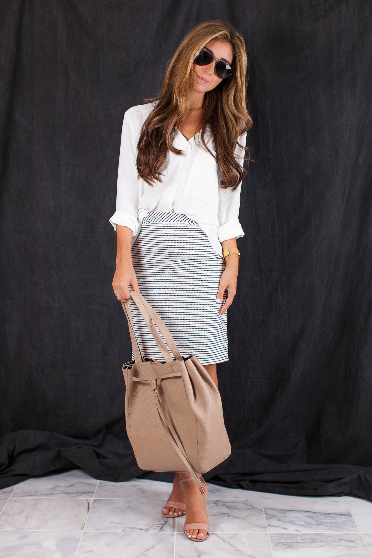 Fashion Blogger The Darling Detail is wearing a Topshop Slouchy Pocket Long Sleeve Blouse, a Halogen Welt Pocket Pencil Skirt, Steve Madden 'Carrson' Sandals, a Larsson & Jennings 'Lugano' Mesh Strap Watch, and is holding a BP. Faux Leather Drawstring Tote.