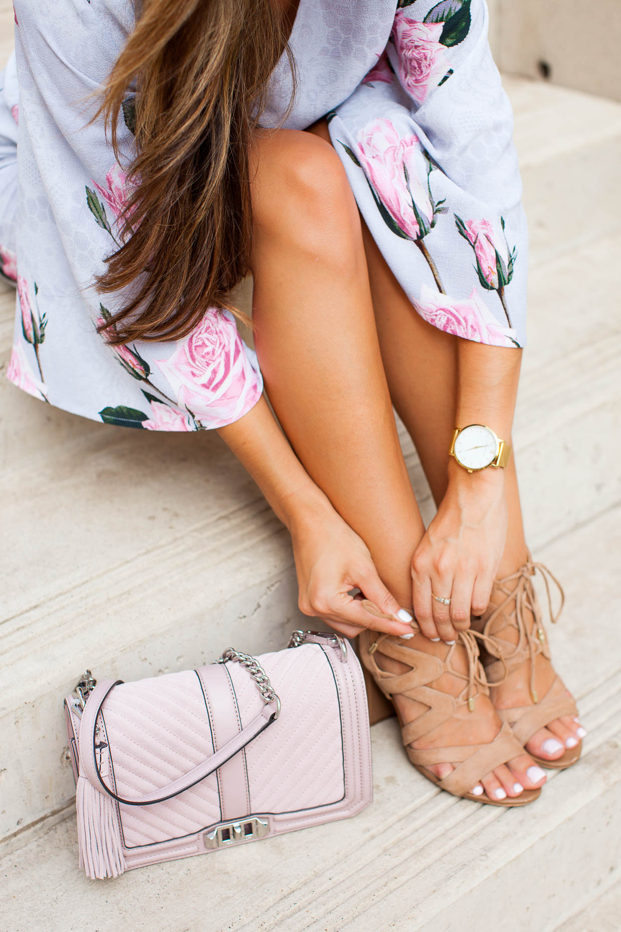 The Darling Detail is wearing a Glamorous Floral Lace Kimono Romper, Same Edelman 'Yardley' Lace-Up Sandals, a Larsson & Jennings 'Lugano' Mesh Strap Watch, and is carrying a Rebecca Minkoff 'Love' Crossbody Bag.