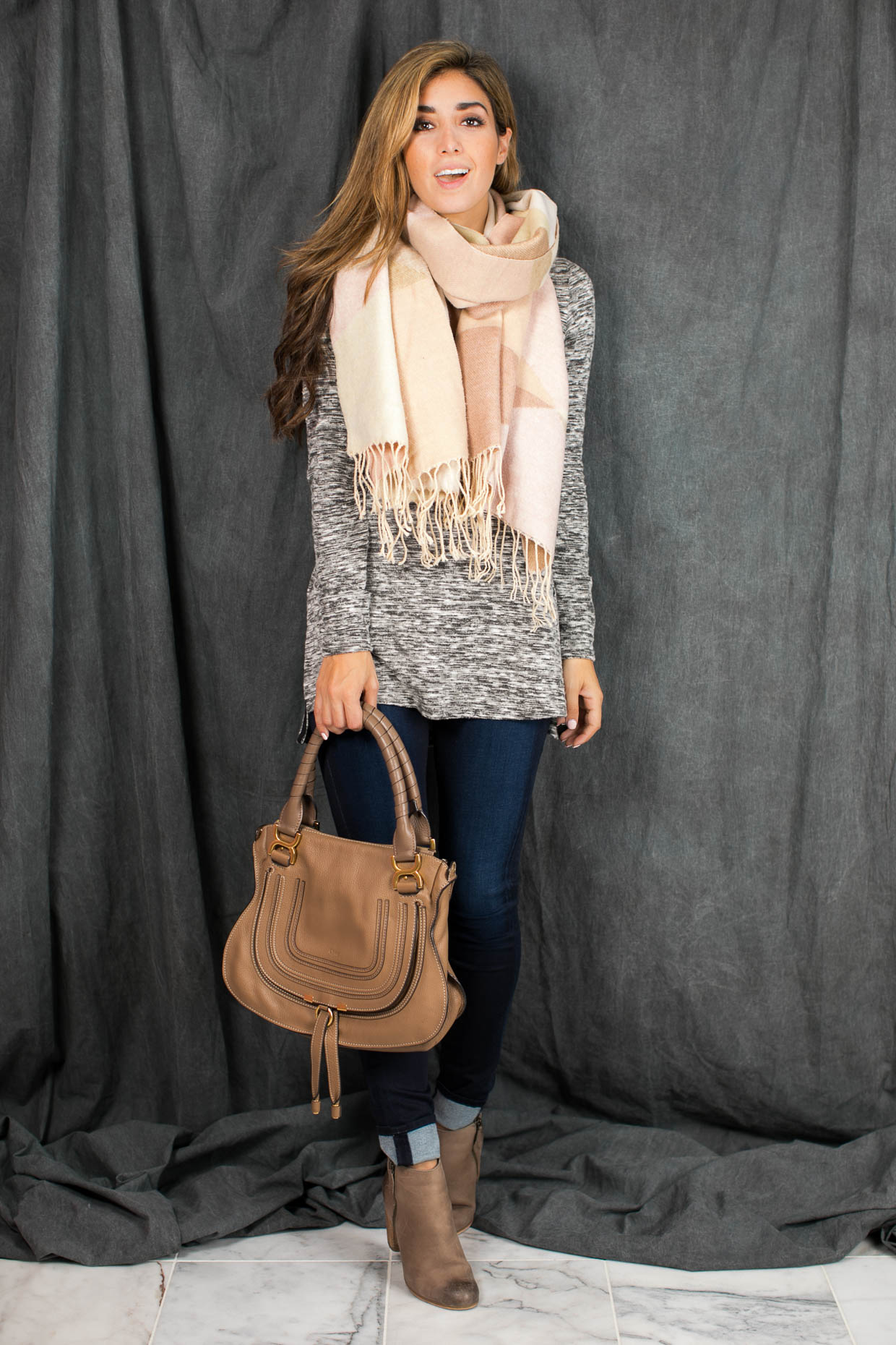 The Darling Detail is wearing a Splendid Silver Mountain Jersey V Neck Tunic, The Jegging by Splendid, a blanket scarf and is holding the Chloe Marcie Medium Satchel Bag.