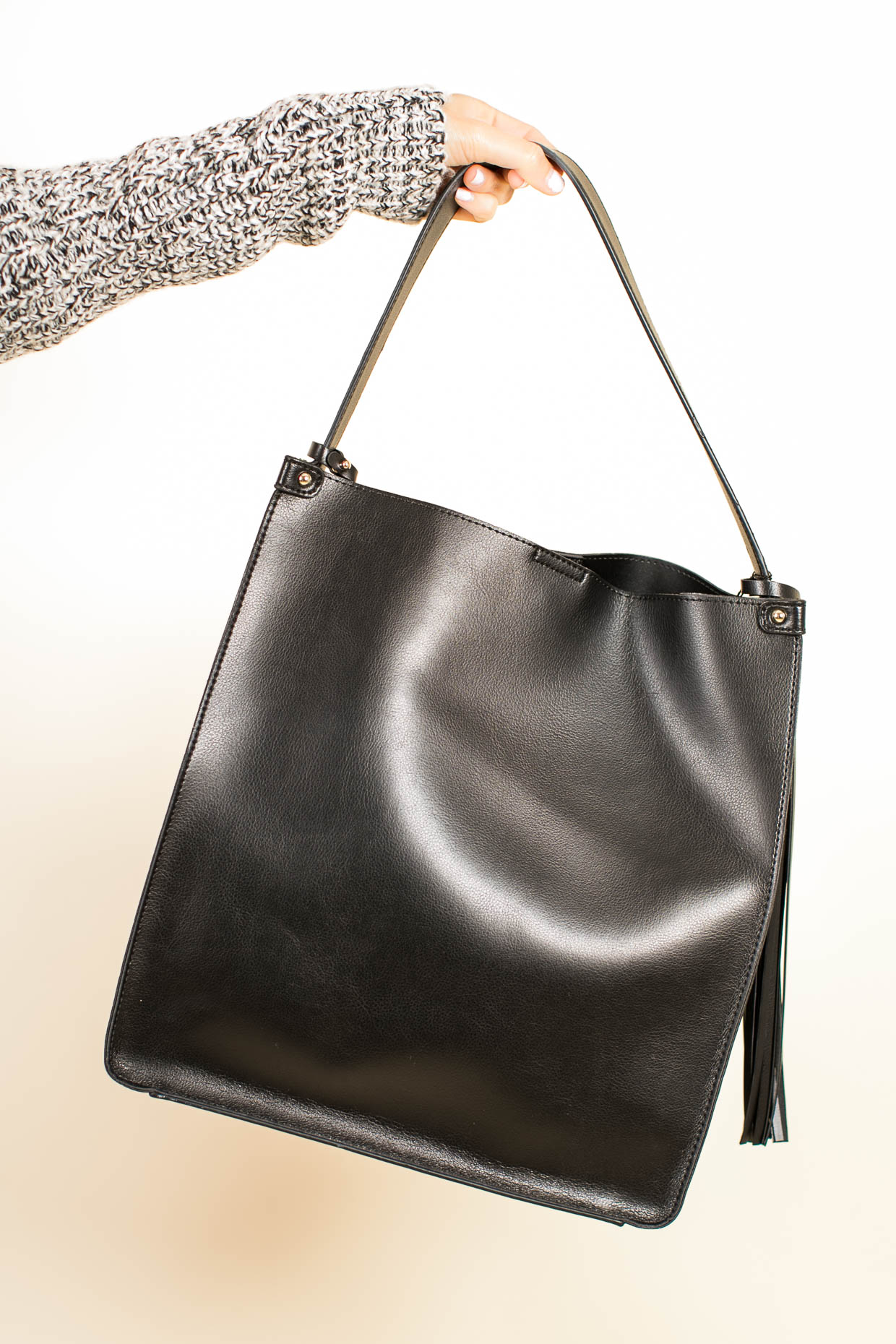 Fashion blogger The Darling Detail wears Sole Society Karlie Faux Leather Bucket Bag