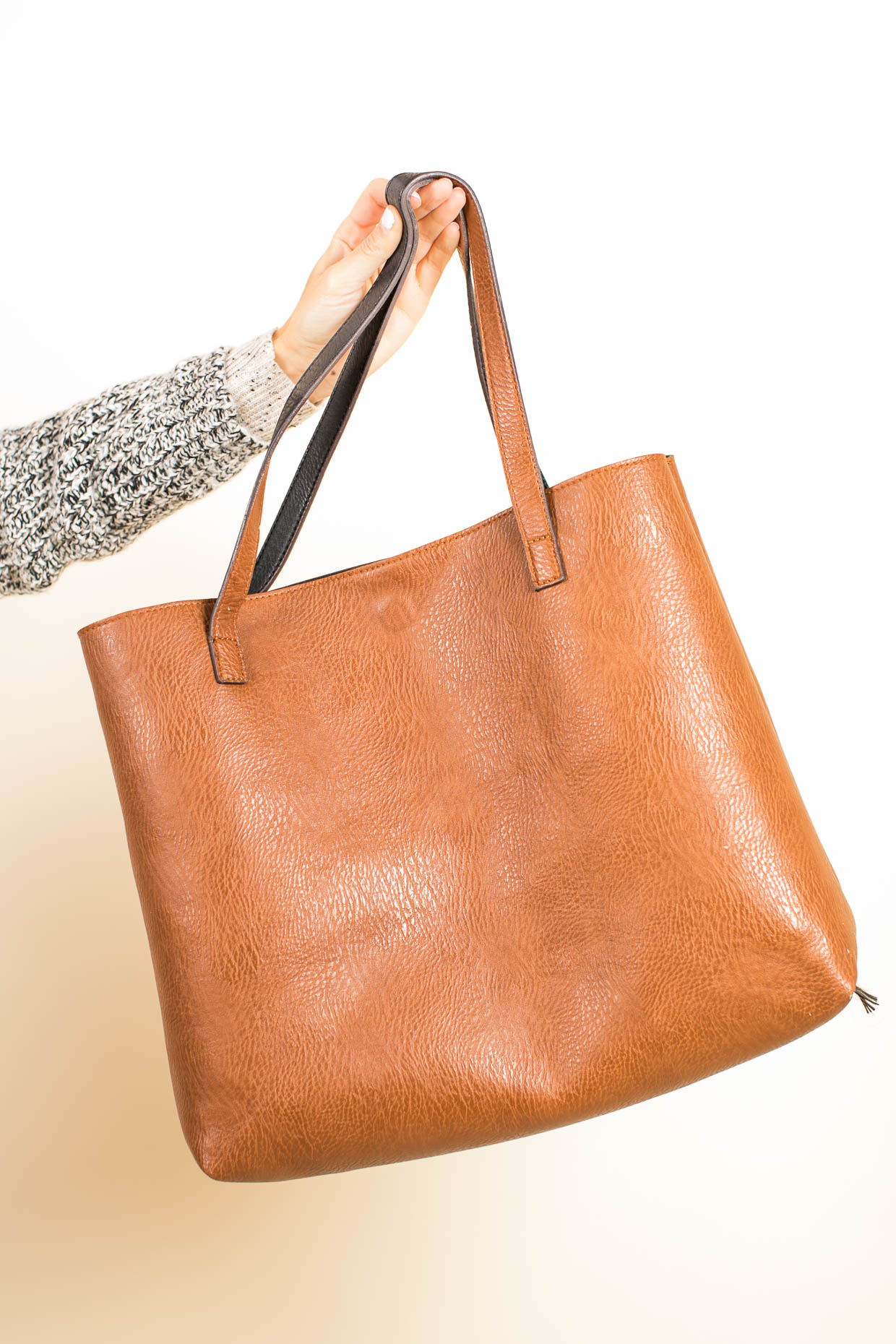 Fashion blogger The Darling Detail wears Street Level Reversible Faux Leather Tote