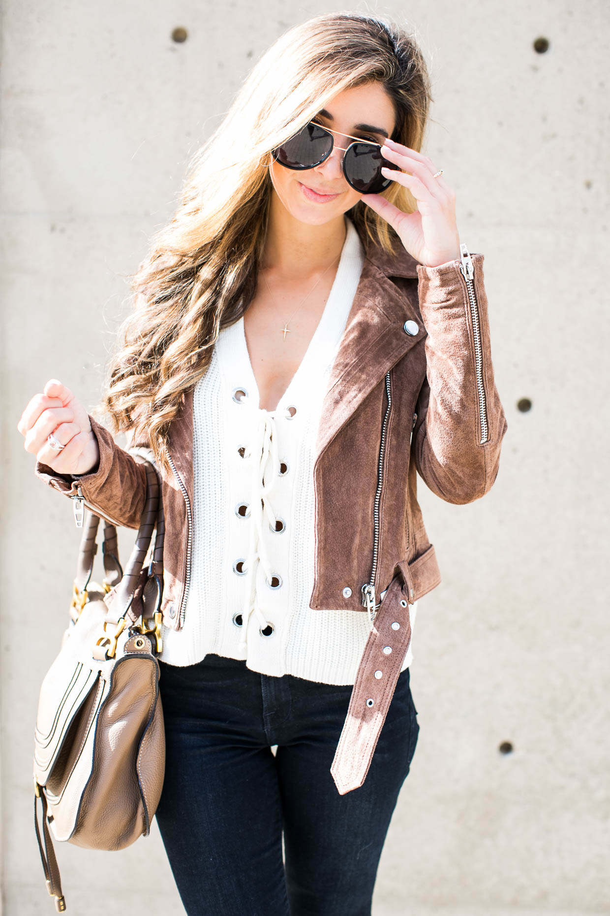 Fashion blogger The Darling Detail wears Lush Lace-Up Sweater, BLANKNYC Morning Suede Moto Jacket, FRAME 'Le High Skinny', High Rise Crop Jeans (Sterling), Quay Australia 'Needing Fame' 65mm Aviator Sunglasses, Larsson & Jennings 'Lugano' Mesh Strap Watch, Petite Albion Ring with Morganite and Diamonds, and Chloé 'Medium Marcie' Leather Satchel