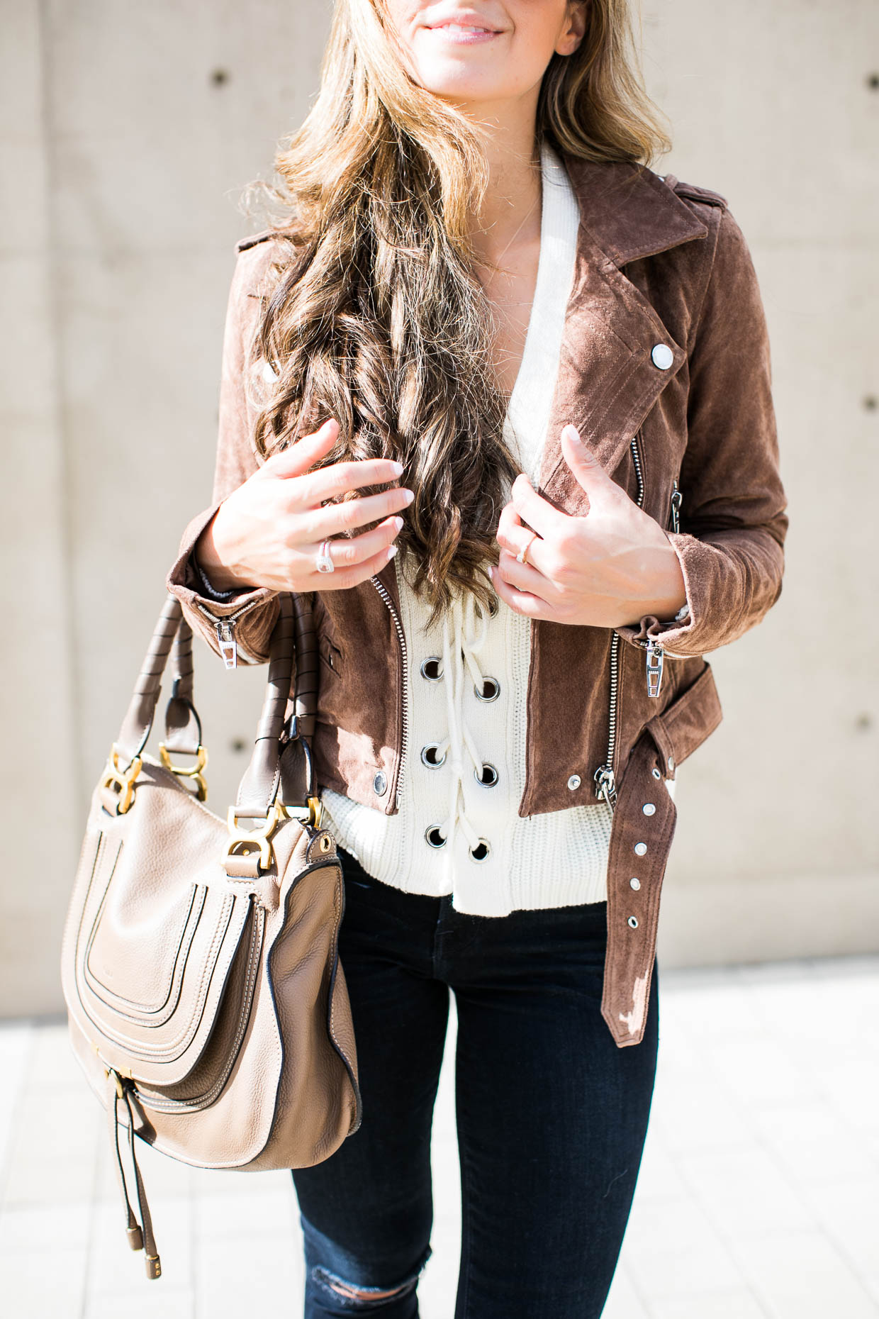 Fashion blogger The Darling Detail wears Lush Lace-Up Sweater, BLANKNYC Morning Suede Moto Jacket, FRAME 'Le High Skinny', High Rise Crop Jeans (Sterling), Larsson & Jennings 'Lugano' Mesh Strap Watch, Petite Albion Ring with Morganite and Diamonds, and Chloé 'Medium Marcie' Leather Satchel