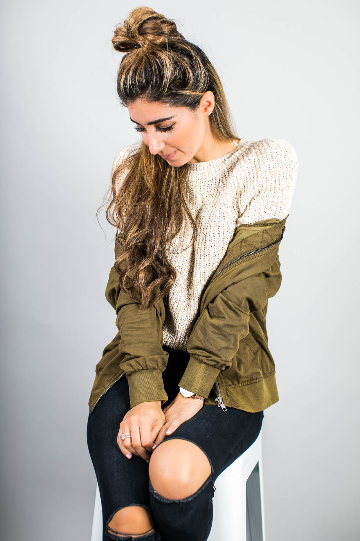 Fashion blogger The Darling Detail wears Free People Electric City Pullover Sweater, Hinge Bomber Jacket, FRAME 'Le High Skinny' High Rise Crop Jeans (Sterling), Larsson & Jennings 'Lugano' Mesh Strap Watch, and Petite Albion Ring with Morganite and Diamonds