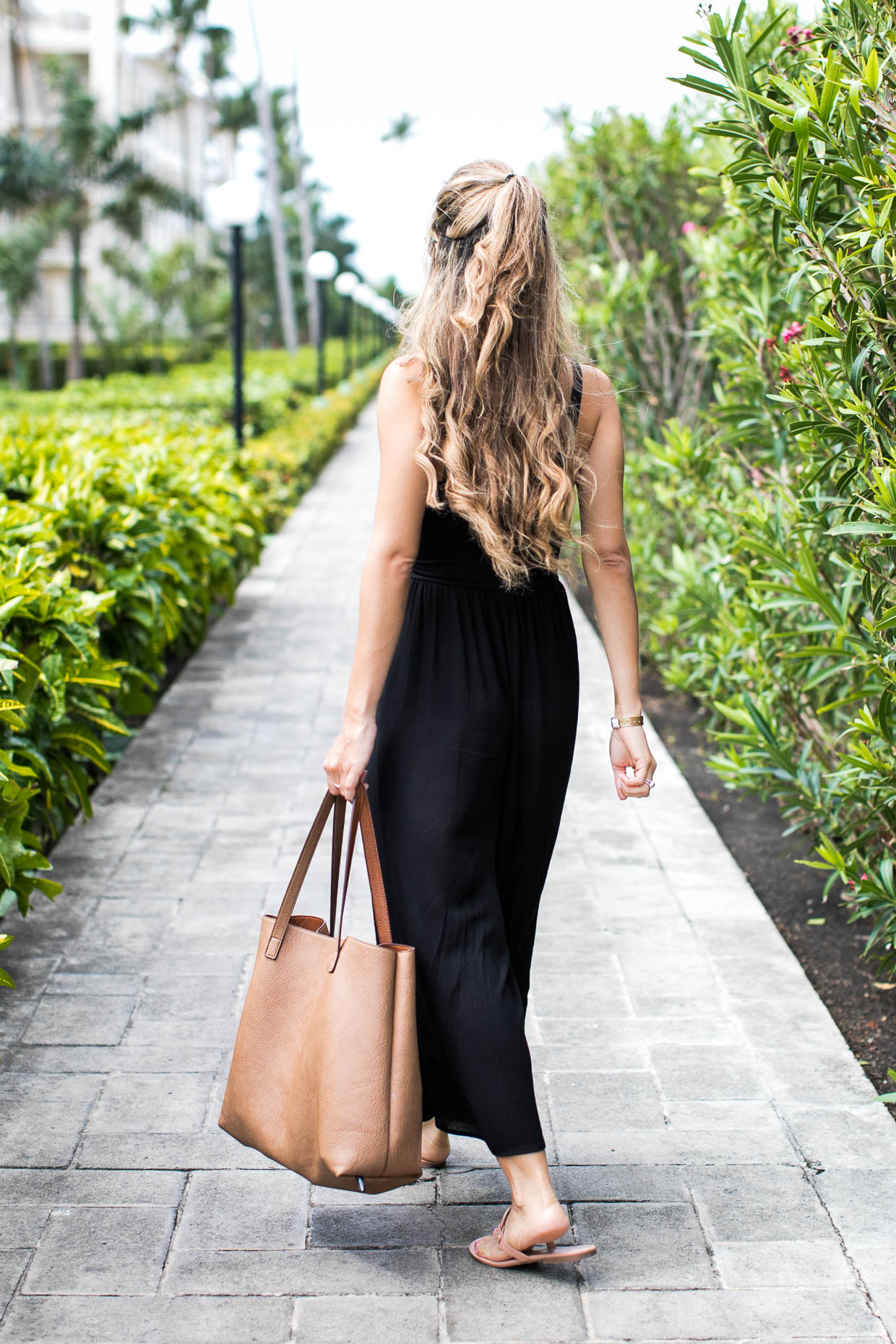 Fashion blogger The Darling Detail wears Lush Gauze Gaucho Jumpsuit, After Dark Knocker Earring, Tory Burch Miller Flip Flop, Brixton Johanna Straw Hat, Street Level Reversible Faux Leather Tote, and Petite Albion Ring with Morganite and Diamonds