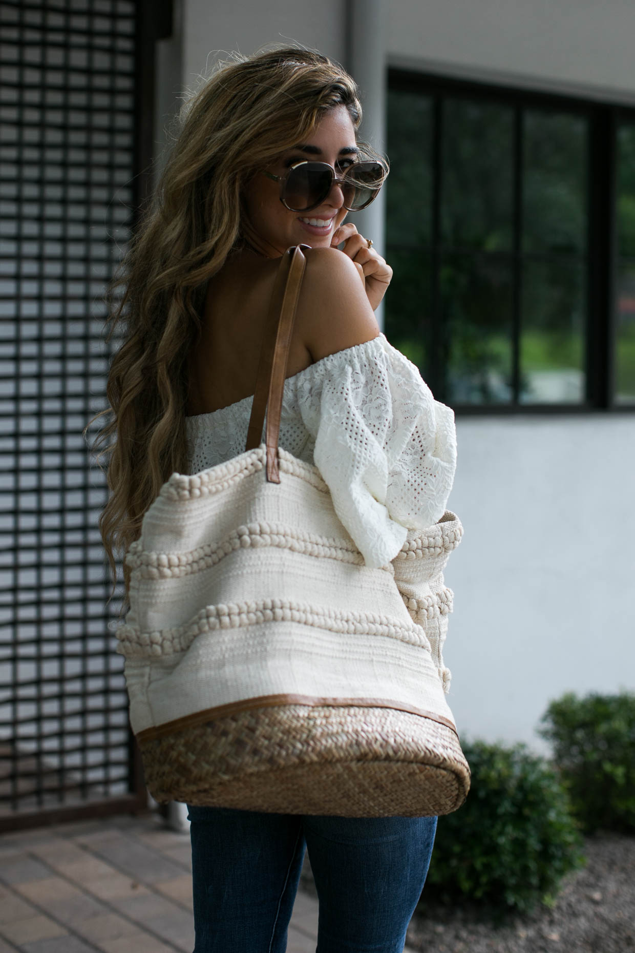 Fashion blogger The Darling Detail wears lace off-the-shoulder top and cropped denim